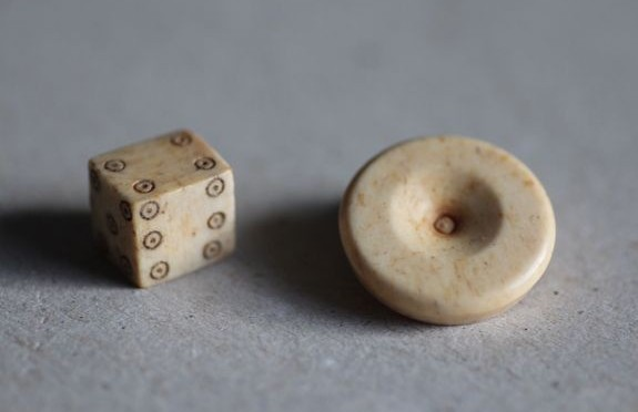 Board game pieces found in settlement built on Roman military fort